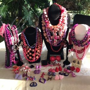 Large lot of pink red and purple jewelry.